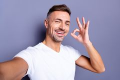Close up photo amazing positive he him his middle age macho perfect appearance easy-going make take selfies hand arm royalty free stock image