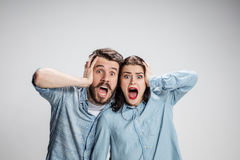Close up photo of angry man and woman touching their heads Stock Images
