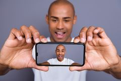 Close up photo attractive dark skin he him his macho short hairdo make take selfies great pictures size quality yeah yes. Facial expression wearing white t royalty free stock image