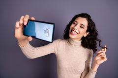Close up photo attractive funny she her lady hold hands arms telephone make take selfies speak skype boyfriend wind. Close up photo attractive funny she her lady royalty free stock photos