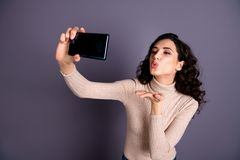 Close up photo attractive she her wavy lady hold hands arms telephone make take selfies send air kiss friends boyfriend. Close up photo attractive she her wavy stock photo