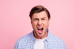 Close up photo of attractive but outraged he him his man mouth grinning screaming on epic fail of favorite team wearing. Casual shirt outfit isolated on pale royalty free stock photo