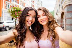 Close up photo of attractive trendy cute teens teenager making photos following blogs bloggers travel share royalty free stock photography