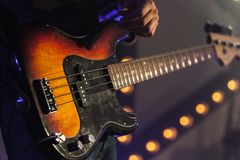 Bass guitar in guitarist hands Royalty Free Stock Photo