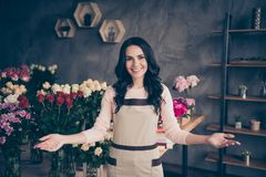 Close up photo beautiful adorable amazing she her lady invite gesture please come in hands arms opening meeting many. Roses vases retail seller assistant owner stock photo