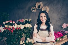 Close up photo beautiful adorable amazing she her lady many roses vases retail seller assistant employee hands arms. Together crossed confident opening service royalty free stock photo