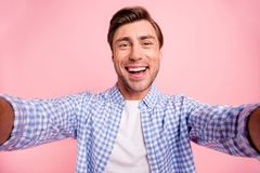 Close up photo of beautiful amazing brunet he him his handsome hold telephone in arms make take selfie wear casual stock photos