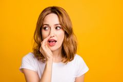 Close up photo beautiful amazing she her foxy lady hold arm hand talking tell speak say secrecy information news novelty. Not loud chatterbox wear casual white stock photography
