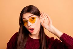 Close up photo beautiful amazing she her lady chatterbox sharing say news listen sound arms near ear wear sun specs. Casual red burgundy knitted pullover stock image