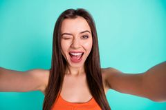 Close up photo beautiful amazing her she lady coquette make take selfies tell speak say skype wink one eye flirty toothy. Wear casual orange tank-top  bright stock images