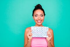 Close up photo beautiful amazing she her lady funny hairstyle hold hands arms paper calendar great mood vacation is. Coming sunny day wear casual pink tank-top stock photo