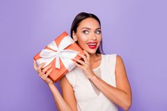 Close up photo beautiful amazing she her lady hold giftbox hands arms wondered look side empty space allure tempting. Lips pomade wear white formal-wear dress royalty free stock photos