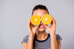 Close up photo beautiful amazing she her lady hold hands arms big large two half slices orange hide eyes spectacles royalty free stock photo