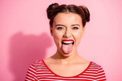 Close up photo beautiful amazing she her lady impolite careless pretty hairdo two buns bright pomade allure big lips. Tongue out mouth wear casual striped red stock image