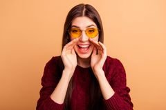 Close up photo beautiful amazing she her lady open mouth sharing say news loud sound arms near mouth wear sun specs. Casual red burgundy knitted pullover stock photography