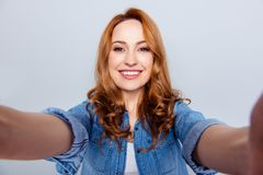 Close up photo beautiful amazing she her lady skype connection tell speak make take selfies modern technology show. Perfect ideal teeth wear casual blue jeans royalty free stock image