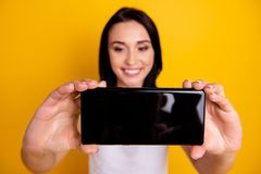 Close up photo beautiful amazing she her lady telephone arms make take selfies speak talk tell skype parents friends. Close up photo beautiful amazing she her stock image