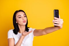 Close up photo beautiful amazing she her lady telephone hand arm make take selfies send air kiss speak talk tell skype. Close up photo beautiful amazing she her royalty free stock photos