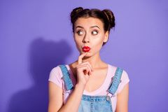 Close up photo beautiful amazing she her lady two buns look side empty space wait hear new rumours chatterbox wear. Casual t-shirt jeans denim overalls clothes royalty free stock photography