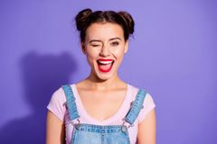 Close up photo beautiful amazing she her lady two buns open mouth wink boys guys cheerful pretty red lips pomade wear. Casual t-shirt jeans denim overalls stock photography