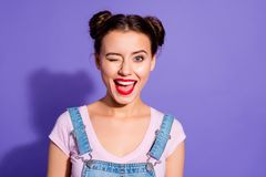 Close up photo beautiful amazing she her lady two buns open mouth wink boys guys cheerful pretty red lips pomade wear. Casual t-shirt jeans denim overalls stock photo