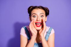Close up photo beautiful amazing she her lady two buns perfect white teeth hands arms near mouth yelling loudly news. Wear casual t-shirt jeans denim overalls stock images