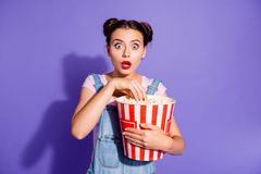 Close up photo beautiful amazing she her lady two buns watch tv show hold popcorn bucket eyes full fear mouth open wear stock photo