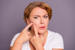 Close up photo beautiful amazing mature she her lady oh no facial expression hold hands arms cheek cheekbone terrible. Result using cream wrinkled more wear royalty free stock photos