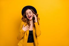 Close up photo beautiful funky she her lady arm hand telephone chat speak talk say tell friends relatives humor joke. Story wear specs formal-wear costume suit stock photography