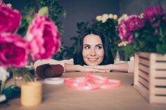 Close up photo beautiful funny funky she her lady face leaning hands arms table many vases pink ribbon composition. Handmade bunch fresh flowers condition stock photo