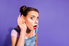 Close up photo beautiful funny funky she her lady two buns hear rumours like news red lipstick pomade hand arm wear. Casual t-shirt jeans denim overalls clothes royalty free stock images