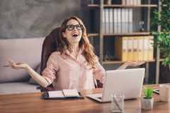 Close up photo beautiful she her business lady hand arm head raised up laugh laughter big salary income earnings genius. Startup notebook table sit office chair royalty free stock photo