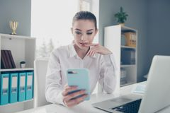 Close up photo beautiful she her business lady look wondered app screen hands arms telephone excited skype speak tell. Boyfriend notebook table wear specs royalty free stock image