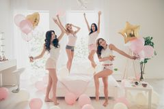 Close up photo beautiful she her fancy pretty cute classy ladies white bed linen sheets bright room balloons festive royalty free stock image