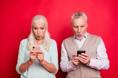 Close up photo beautiful she her he him his aged white hair guy lady couple partners hold hands arms telephones reader royalty free stock images