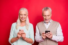 Close up photo beautiful she her he him his aged white hair guy lady partners hold hands arms telephones texting stock photography