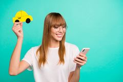 Close up photo beautiful she her lady arm hold telephone smart phone paper yellow taxi car advising use user best speed royalty free stock images