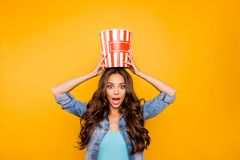 Close up photo beautiful her she lady hold big large popcorn box on head stupor oh no expression change channel wear. Blue teal green short dress jeans denim royalty free stock images