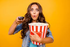 Close up photo beautiful her she lady hold big large popcorn box stupor staring oh no expression change channel wear. Blue teal green short dress jeans denim stock photo