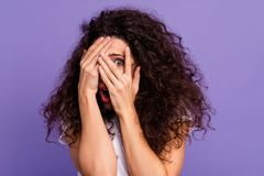 Close up photo beautiful her she lady model unexpected arms hands fingers hide face eyes full fear open mouth oh no. Expression wear casual white t-shirt stock image