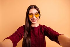 Close up photo beautiful her she lady modern look make take selfies instagram post followers speak talk tell skype video. Call wear specs casual red burgundy stock image