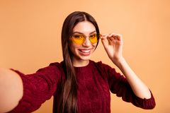 Close up photo beautiful her she lady modern look make take selfies instagram post followers speak tell skype friends. Parents wear specs casual red burgundy royalty free stock photo