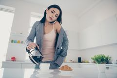 Close up photo beautiful she her lady pour cup hot beverage croissant table late job quickly dressing jacket blazer. Close up photo beautiful she her lady pour stock photos