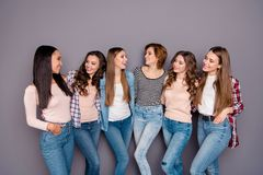 Close up photo beautiful she her six ladies skinny roommates sisters hold each other posing hugging look interest. Wearing casual jeans denim checkered striped royalty free stock photography