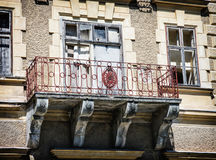 Close up photo of beautiful old house with artistic balcony Stock Photo