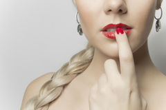 Close-up photo of a beautiful red female lips. Girl portrait Stock Photos