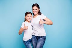 Close up photo beautiful two people brown haired mom little daughter show thumbs in air recommending hugging best stock photos