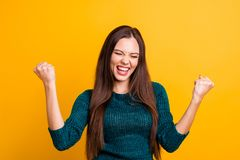 Close up photo beautiful yelling her she lady eyes closed open toothy mouth arms fists raised up air brown eyes ecstatic. Wear green knitted pullover jumper royalty free stock photos