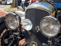 1928 Bentley, front grill and head lights. Close up photo of a 1928 Bentley grill and head lights royalty free stock photography