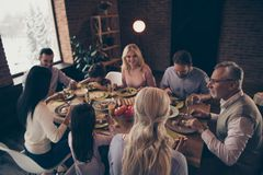Close up photo big large family thanksgiving conversation talk chat members brother sister granny mom dad grandpa little stock image